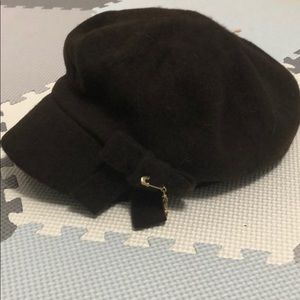 Juicy Couture messenger cap style brown hat